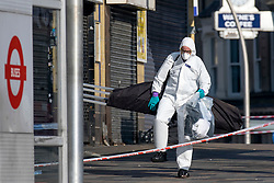 © Licensed to London News Pictures. 27/02/2019. London, UK. A forensic investigator attend the scene outside Ilford Station, where a 20-year-old man was fatally stabbed last night. A murder investigation has been launched. Photo credit: Rob Pinney/LNP