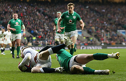 England's Elliot Daly scores his sides opening try during the NatWest 6 Nations match at Twickenham Stadium, London.