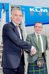 Inverness Airport welcomed KLM's Inaugural flight from Amsterdam. To celebrate the new route, the first flight from Schiphol, Amsterdam was greeted by a water cannon salute upon arrival.  On board were Barry ter Voert, Senior Vice President, Air France KLM European Markets and Wilco Swejen, Director for Aviation Marketing, Schipol Airport.  Provost Helen Carmichael, The Highland Council, Inglis Lyon, Managing Director of Highlands and Islands Aiports and Drew Hendry MP (Inverness, Nairn, Badenoch and Strathspey) met the delegation, officially welcoming the group to the Highlands. <br /> <br /> Pictured L-R: Barry ter Voert, Senior Vice President, Air France KLM Eorpoean Markets, Inglis Lyon, Manging Director of Highlands and Islands Airports<br /> <br /> Malcolm McCurrach | EEm | Tue, 17, May, 2016
