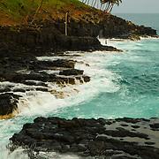 Fishermen dare the waves at Boca do Inferno.