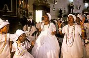 """Women celebrate the  patron saint of the """" Baiana do Acaraje"""" in Pelorinho's church of Nossa Senhora dos Rosarios dos Pretos, Salvador de Bahia, Brazil"""