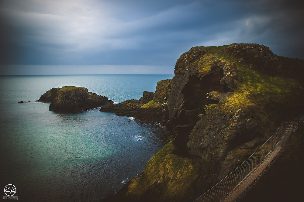 """{County Antrim : 2015} I awoke in the tiny camper van a little chilled but still somewhat warm. Threw on what I was hoping were clean clothes and began to make instant, flavorless coffee and pack my 40 lb Camera Bag. Minutes later I slid open the giant door to start a walk uphill to Carrick-a-Rede Rope Bridge. It was cold and windy and early. Some I have told this story to have called this """"Roughing It"""".<br /> Rewind 350 years. There is a Man my age waking up from his tent made of cloth. He is not having coffee this morning because the fire will not start due to the wind. He starts his hike in the clothes he slept with and has been wearing that past few days. He's also carrying up to 100 lbs. of Fishing line and Net uphill to fish for Salmon. Upon arriving to the Rope Bridge there is no hesitation, even with the site of giant holes in the floor and only a single piece of rope to hold onto. After a full day of fishing he carries his catch and gear back on the same bridge in the same heavy wind only to wake up and do it again the next day. I'd say, that is Roughing It."""