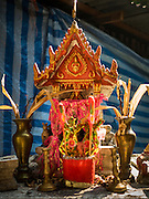 08 APRIL 2016 - BANGKOK, THAILAND:   A Thai Spirit House in front of a home in Mahakan Fort. The community is known for fireworks, fighting cocks and bird cages. Mahakan Fort was built in 1783 during the reign of Siamese King Rama I. It was one of 14 fortresses designed to protect Bangkok from foreign invaders, and only of two remaining, the others have been torn down. A community developed in the fort when people started building houses and moving into it during the reign of King Rama V (1868-1910). The land was expropriated by Bangkok city government in 1992, but the people living in the fort refused to move. In 2004 courts ruled against the residents and said the city could take the land. The final eviction notices were posted last week and the residents given until April 30 to move out. After that their homes, some of which are nearly 200 years old, will be destroyed.   PHOTO BY JACK KURTZ