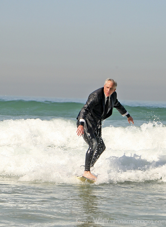 An Executive takes an alternative commute to office, surfing.
