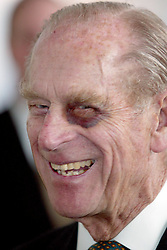 Sporting a black-eye, the Duke of Edinburgh smiles as he tours the new Baglan Power Station in Port Talbot, South Wales.