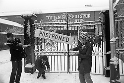 Tottenham supporters Julie Holmes and Janet Sheed, both 14, and 15-year-old Laura Jones, enjoy a snowball fight outside the gates of White Hart Lane. A First Division match between Spurs and Everton was postponed due to the weather.