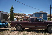 """Water Warriors volunteer Leon Curley backs his truck, """"Bouncing Betty,"""" out of Stella Valdez's property in Pretty Rock, near the White Rock Chapter of the Navajo Nation."""