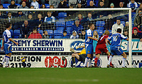 Photo: Paul Greenwood.<br />Wigan Athletic v Liverpool. The Barclays Premiership. 02/12/2006. Liverpool's Dirk Kuyt, (centre red) scores past the static Wigan defence