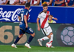 September 14, 2018 - Huesca, U.S. - HUESCA, SPAIN - SEPTEMBER 14: Serdar, midfielder of SD Huesca competes for the ball with Alex Moreno defender of Rayo Vallecano de Madrid during the La Liga game between SD Huesca and Rayo Vallecano de Madrid  at Estadio El Alcoraz on September 14, 2018, in Huesca, Spain. (Photo by Carlos Sanchez Martinez/Icon Sportswire) (Credit Image: © Carlos Sanchez Martinez/Icon SMI via ZUMA Press)
