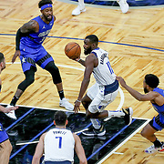ORLANDO, FL - MARCH 01: Tim Hardaway Jr. #11 of the Dallas Mavericks splits the defense of Chasson Randle #25 of the Orlando Magic, Terrence Ross #31 of the Orlando Magic and Nikola Vucevic #9 of the Orlando Magic during the second half at Amway Center on March 1, 2021 in Orlando, Florida. NOTE TO USER: User expressly acknowledges and agrees that, by downloading and or using this photograph, User is consenting to the terms and conditions of the Getty Images License Agreement. (Photo by Alex Menendez/Getty Images)*** Local Caption *** Tim Hardaway Jr.; Chasson Randle; Terrence Ross; Nikola Vucevic