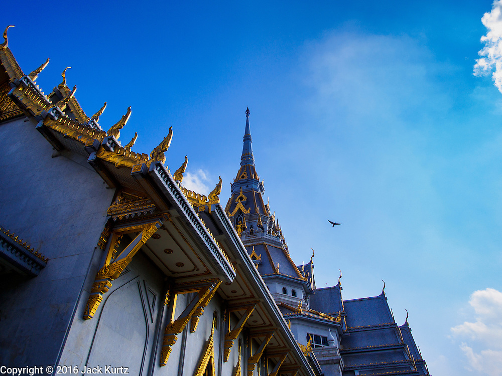 14 JANUARY 2016 - CHACHOENGSAO, CHACHOENGSAO, THAILAND: The roofline of Wat Sothon. Wat Sothon, in Chachoengsao, is one of the largest Buddhist temples in Thailand. Thousands of people come to the temple every day to pray for good luck, they make merit by donating cooked eggs and cash to the temple. The temple dates from the Ayutthaya period (circa 18th century CE).        PHOTO BY JACK KURTZ
