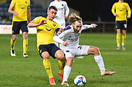 Shrewsbury Town midfielder (on loan from Blackburn Rovers) Harry Chapman (32) battles for possession with Oxford United midfielder Cameron Brannagan (8) during the EFL Sky Bet League 1 match between Oxford United and Shrewsbury Town at the Kassam Stadium, Oxford, England on 13 April 2021.