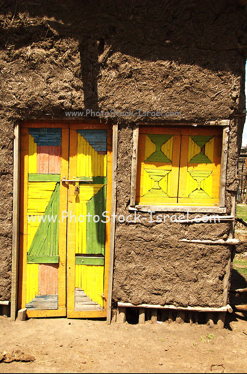 Africa, Ethiopia, Konso mud hut with vivid door and window