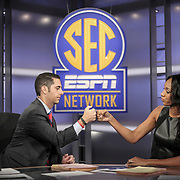 Dari Nowkhah and Maria Taylor get ready to go live for the first time ever during launch of the SEC Network in Charlotte. ©Travis Bell Photography