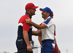 Team USA's Bryson Dechambeau (left) and Team Europe's Sergio Garcia shake hands on the 16th green during day three of the 43rd Ryder Cup at Whistling Straits, Wisconsin. Picture date: Sunday September 26, 2021.