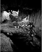 THE ATLANTIC WALL. .pic shows: FRANCE. THE BOMED RUINS OF A  GUN BATTERY AT LONGUES-SUR-MER NEAR ARROMANCHES ON THE NORMANDY  BEACHES. .WORLD WAR TWO ENDED IN EUROPE IN MAY 1945, THIS YEAR SEES THE 60th ANNIVERSARY OF THAT VICTORY..THE ATLANTIC WALL BUILT BY GERMANY IN WORLD WAR 2 STRETCHED FROM NORWAY VIA DENMARK, HOLLAND, BELGIUM AND FRANCE TO THE SPANISH BORDER. THE MAIN CONCENTRATION OF BUNKERS,BLOCKHOUSES AND DEFENCES WERE ALONG THE DUTCH, BELGIAN AND FRENCH COASTAL AREAS MOST UNDER THREAT FROM AN ALLIED INVASION. THE CONSTRUCTION OF THE WALL BEGAN IN 1942 AND CONTINUED UP UNTIL THE JUNE 6th ALLIED INVASION ON D-DAY IN 1944..TENS OF THOUSANDS OF WORKERS AND PRISONERS FROM THE GERMAN OCCUPIED AREAS OF EUROPE WERE EMPLOYED BY THE ORGANISATION TODT NAMED AFTER FRITZ TODT, THE GERMAN ENGINEER WHO DIED IN 1942 (TO BE SUCEEDED BY ALBERT SPEER) IN THE BUILDING WORK. BETWEEN THE RIVERS LOIRE AND DIVES 87,257 WORKERS WERE USED INCLUDING 55,000 FRENCHMEN, 11,500 GERMANS, 4,200 DUTCH, 6.600 BELGIANS, 2,600 NORTH AFRICANS AND SEVERAL THOUSAND FROM EASTERN EUROPE..THE ATLANTIC WALL WAS THE LARGEST BUILDING PROJECT SINCE THE ROMAN EMPIRE. MANY OF THE COLOSSAL GUN BUNKERS AND UNDERGROUND DEFENSIVE CHAMBERS REMAIN. SOME HAVE FALLEN FROM CLIFF TOP POSITIONS WHILE OTHERS ARE PARTLY CONSUMED BY SAND DUNES. THE RAVAGES OF WAR, TEN THOUSAND TON BOMBS AND 60 YEARS OF COASTAL WEATHER HAVE HARDLY AFFECTED THESE LEVIATHAN LIKE STRUCTURES WHICH LOOK LIKELY TO LAST AS LONG AS THE RUINS OF ANCIENT ROME. A FITTING REMINDER OF A WORLD THAT COULD HAVE BEEN FROM 60 YEARS AGO..COPYRIGHT PHOTOGRAPH BY BRIAN HARRIS  © 2005.07808-579804
