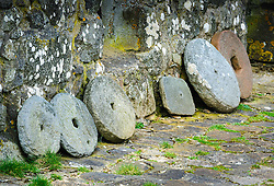 Old millstones at the Skye Museum of Island Life, Kilmuir, Isle of Skye, Scotland<br /> <br /> (c) Andrew Wilson | Edinburgh Elite media