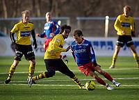 Fotball, Adecco-ligaen, 23.04.06, Tromsdalen - Moss<br /> Amin Askar (Moss) og Espen Minde (Tromsdalen)<br /> Foto: Tom Benjaminsen, Digitalsport