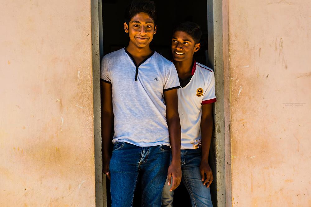Young men at Bandarawela train station, Train trip through the scenic mountains featuring many tea plantations between Nuwara Eliya (Nanu Oya) to Ella, Sri Lanka.