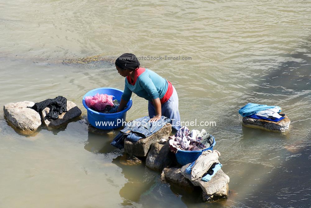 Madagascar, Analamanga region, River landscape near Antananarivo, Women washing clothes in the river