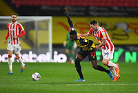 Football - 2020 / 2021 Sky bet Championship - Watford vs Stoke City - Vicarage Road<br /> <br /> Watford's Ismaïla Sarr holds off the challenge from Stoke City's Jordan Thompson.<br /> <br /> COLORSPORT/ASHLEY WESTERN
