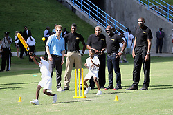 Prince Harry and cricketers Andy Roberts, Vivian Richards and Curtly Ambrose attend a youth sports festival at the Sir Vivian Richards Stadium in North Sound, Antigua, on the second day of his tour of the Caribbean.