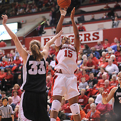 Feb 21, 2009; Piscataway, NJ, USA; Rutgers center Kia Vaughn (15) takes a shot over Providence forward Emily Cournoyer (33) during the second half of Rutgers' 55-42 victory over Providence at the Louis Brown Athletic Center.