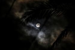 June 10, 2017 - Gaza, Palestine - A full moon rises over Deir Al-balah City, on, June 11,2017. (Credit Image: © Sameh Rahmi/NurPhoto via ZUMA Press)
