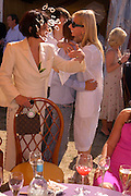 Isabella Blow and Marguerita Wennberg. Veuve Clicquot Gold Cup Final at Cowdray Park. Midhurst. 17 July 2005. ONE TIME USE ONLY - DO NOT ARCHIVE  © Copyright Photograph by Dafydd Jones 66 Stockwell Park Rd. London SW9 0DA Tel 020 7733 0108 www.dafjones.com