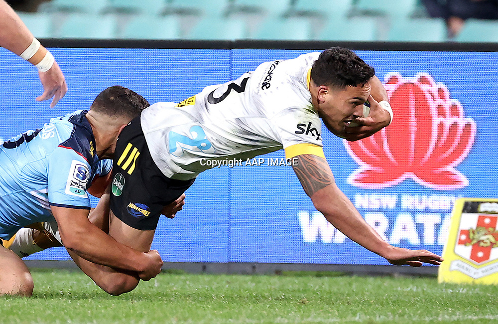 Izaia Perese from the NSW Waratahs fails to stop Billy Proctor of the Wellington Hurricanes from scoring a try during the Round 1 Trans-Tasman Super Rugby match between the NSW Waratahs and the Wellington Hurricanes at the SCG in Sydney, Friday, May 14, 2021.  (AAP Image/David Gray) NO ARCHIVING, EDITORIAL USE ONLY