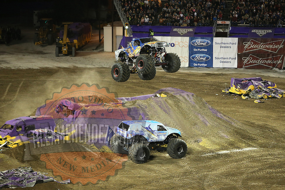 Stone Crusher driven by Steve Sims is seen jumping over Monster Truck Hooked, during the Monster Jam big truck event at the Citrus Bowl in Orlando, Florida on Saturday, January 25, 2014. (AP Photo/Alex Menendez)