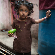 Girl with Fruit - Dharavi, Mumbai, India
