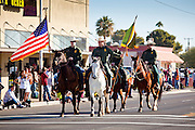 28 JANUARY 2012 - BUCKEYE, AZ:    Members of the US Border Patrol mounted unit ride in the Buckeye Days parade. The Buckeye Days parade went through downtown Buckeye, an agricultural community about 45 miles west of Phoenix. The parade was one the first events to mark Arizona's centennial celebration. Arizona was admitted to the United States on Feb 14, 1912, making it the 48th state in the union. The state celebrates its 100th birthday with a series of events on Feb. 14, 2012.    PHOTO BY JACK KURTZ