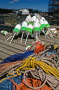 Lobster buoys and ropes on a dock in Tenants Harbor, Maine.