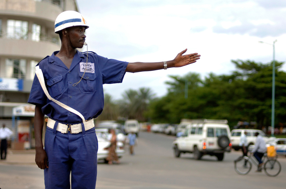 Burundi, November 28, 2005 -  Policeman carries on with traffic  at the street in Bujumbura.