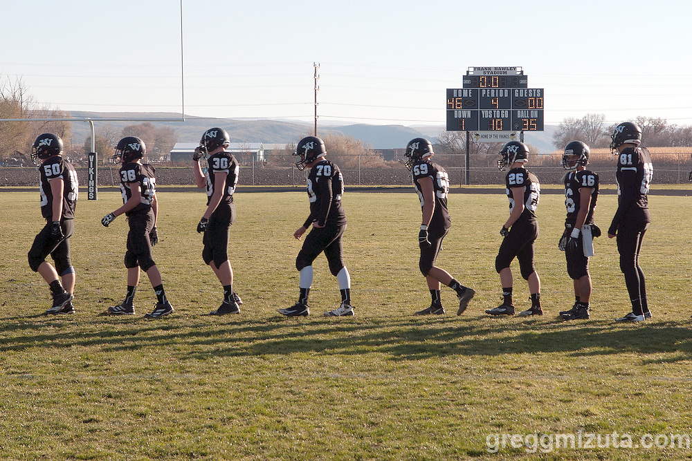 Vale players (L to R: Matthew Carpenter, Seth Clark, Cody Towers, Anthony Guerricagoitia, Garret DeVos, Logan Maag, Brandon Mohamed, Tyson Mesa) in line at the end of the round 1 playoff game against Clatskanie, November 9, 2013 at Frank Hawley Stadium Vale High School, Vale, Oregon. Vale won 46-0.