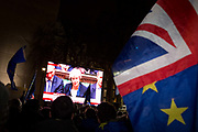 Remain protesters pro-EU listen to Prime Minister Theresa May in parliament after the result of MPs Meaningfull Brexit vote which eventually brought about a massive defeat for her EU deal, on 15th January 2019, in Westminster, London, England.