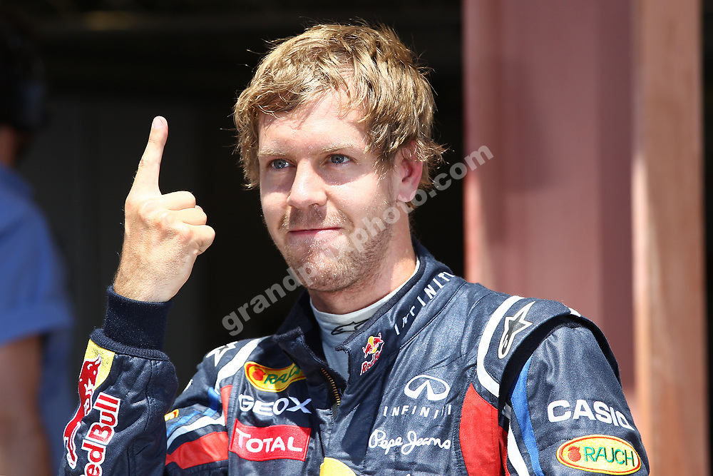 Sebastian Vettel (Red Bull-Racing) and his number one finger after qualifying for the 2011 European Grand Prix in Valencia. Photo: Grand Prix Photo