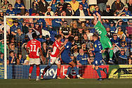AFC Wimbledon goalkeeper Aaron Ramsdale (35) making a save during the EFL Sky Bet League 1 match between AFC Wimbledon and Charlton Athletic at the Cherry Red Records Stadium, Kingston, England on 23 February 2019.