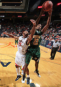 Dec. 20, 2010; Charlottesville, VA, USA; Norfolk State Spartans guard/forward Chris McEachin (35) grabs a rebound in front of Virginia Cavaliers forward Akil Mitchell (25) during the game at the John Paul Jones Arena. Virginia won 50-49. Mandatory Credit: Andrew Shurtleff