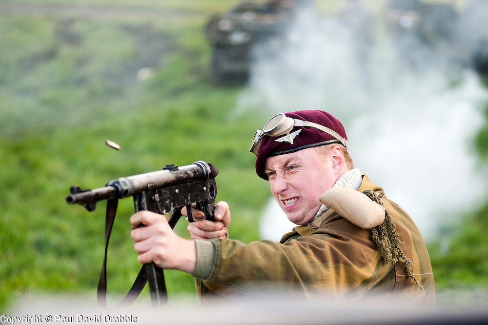Re-enactors portraing British Paras of the 6th airborne division take part in a Battle reenactment on Day two at the Showground Pickering<br /> 14 October 2012<br /> Image © Paul David Drabble