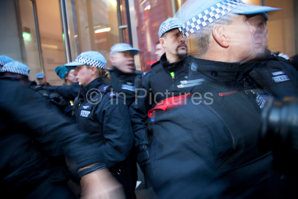 Police try to keep Anti-capitalist protesters under control outside Panton House on Panton Street. Riot police entered and cleared the building. They were targeting Mick Davis, CEO of mining company Xstrata, which has offices in the building and is one of the highest paid from FTSE 100 companies.
