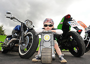 Fionn O'Donoghue-Sheahan (2.5) from Killarney on his trike among some super bikes at the 5th annual Ireland Bike Fest which rook place in Killarney over the weekend.,   Ireland Bike Fest which is supported by Harley-Davidson® Europe, Gleneagle Hotel, Fáilte Ireland, Destination Killarney and Killarney Town Council attraced 30,000 people from all over the world.<br /> Picture by Don MacMonagle