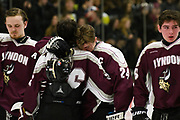 Lyndon's Krystof Vanek (24) and Lyndon's Steve Ferraro hug at the conclusion of the Vermont state division II boys hockey championship game between Lyndon and Woodstock at Gutterson Field House on Monday evening March 19, 2018 in Burlington. (BRIAN JENKINS/for the FREE PRESS)