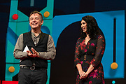 Host Chris Anderson and Sarah Kay speak at TED2019: Bigger Than Us. April 15 - 19, 2019, Vancouver, BC, Canada. Photo: Bret Hartman / TED