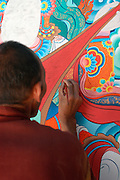 India, Ladakh region state of Jammu and Kashmir, Stakna monastery. A priest painting the walls