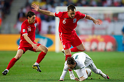 John Terry of England vs Milivoje Novakovic of Slovenia during the 2010 FIFA World Cup South Africa Group C Third Round match between Slovenia and England on June 23, 2010 at Nelson Mandela Bay Stadium, Port Elizabeth, South Africa. England defeated Slovenia 1-0 and qualified for the next round, Slovenia not. (Photo by Vid Ponikvar / Sportida)