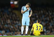 Nicolas Otamendi of Manchester City looks on as Roberto Pereyra of Watford goes down injured during the English Premier League match at The Etihad Stadium, Manchester. Picture date: December 12th, 2016. Photo credit should read: Lynne Cameron/Sportimage