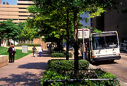 Stock photo of a bus stopped at a bus stop in downtown Houston Texas