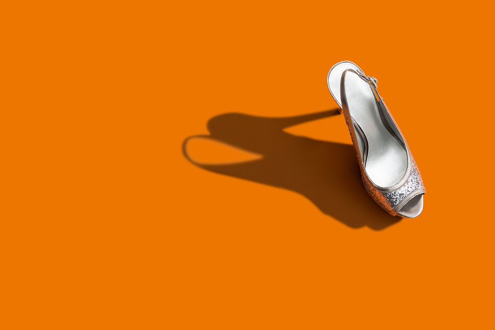 Women's High Heel Shoe on orange Background